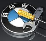 3d illustration of a large wrench and screwdriver sitting on top of a metallic BMW logo over a dark reflective surface
